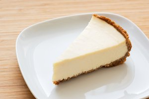 Slice of plain classical cheesecake
