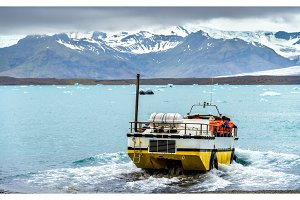 Amphibious vehicle in Jokulsarlon glacier lagoon - Iceland