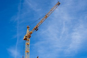 crane on blue sky background in the