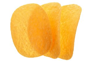 three potato chips on white background close-up. Top view. Flat lay