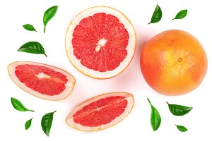 Grapefruit and slices with leaf isolated on white background. Top view. Flat lay pattern