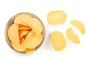 heap of potato chips in wooden bowl on white background close-up