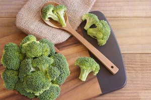 Fresh broccoli over rustic wooden