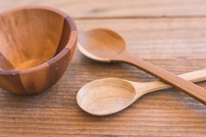 Empty wooden bowl and spoon