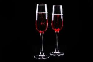 Glass with berries and red champagne