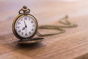 pocket watch on the old wooden