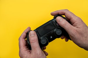 Video games controller in hands