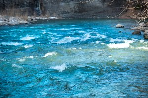 Blue river water with waves