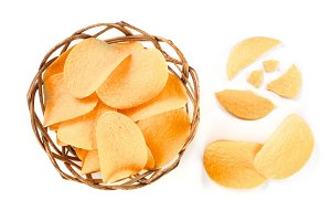 heap of potato chips in wicker basket on white background close-up