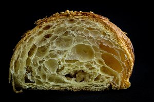 Croissant on black background