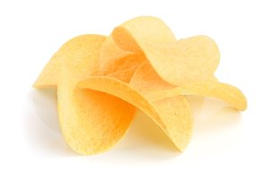 heap of potato chips on white background close-up