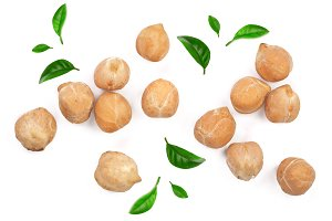 Dry raw organic chickpeas decorated with leaves isolated on white background. Top view