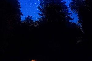 Illuminated orange tent at night