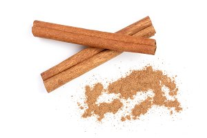 Cinnamon sticks with powder isolated on white background. Top view