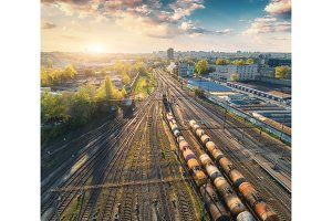 Aerial view of colorful freight trains on railway station