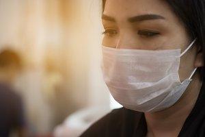 women wearing a dust mask