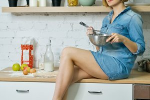Girl preparing food in kitchen
