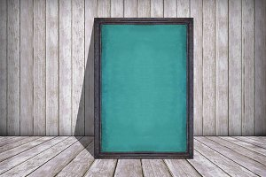 chalkboard in frame and old wooden