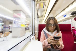 Traveler woman using smart phone.
