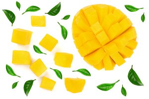 half of Mango fruit with leaves isolated on white background close-up. Top view. Flat lay. fruit composition