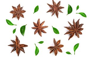 Star anise decorated with leaves isolated on white background. Top view