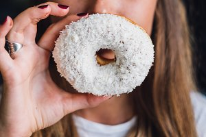 Woman holding donut