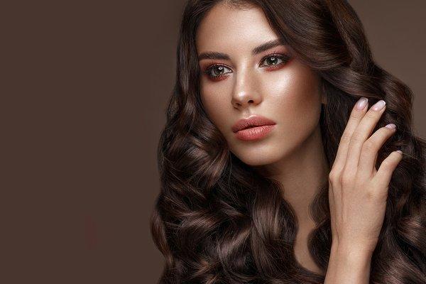 Beautiful brunette model: curls, cl…