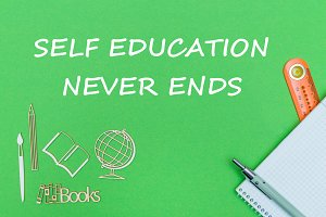 text self education never ends, school supplies wooden miniatures, notebook on green background