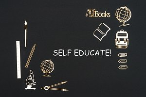 School supplies placed on black background with text self educate