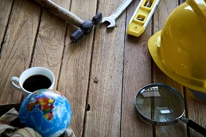 Tools and helmet on the wooden floor