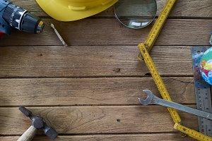 Tools and helmet on the wooden floor