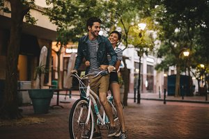 Loving couple riding bicycle