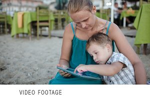 Mother and son using tablet PC near