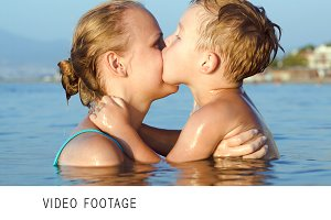 Boy kissing and embracing mother