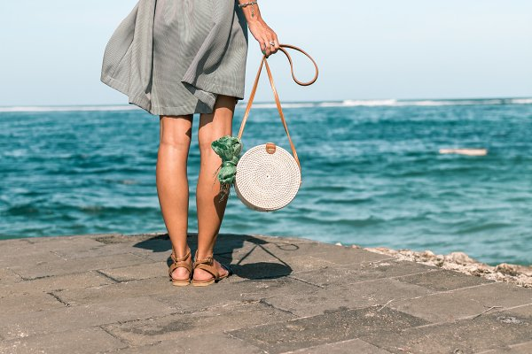 Beauty & Fashion Stock Photos: Belart84 - Woman with fashionable stylish white rattan bag and silk scarf outside. Tropical island of Bali, Indonesia. Rattan handbag and silk scarf.