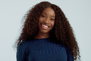 Beauty black mixed race african american woman with long curly hair and perfect smile