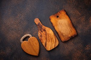Old cutting boards on rusty background