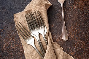 Vintage forks on rusty background