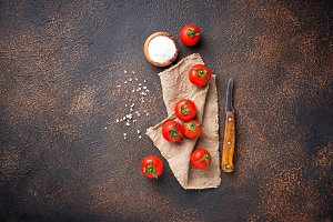 Fresh cherry tomatoes on rusty background