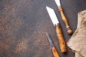 Old vintage knife on rusty background