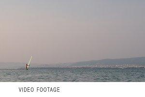 Windsurfer sailing in quiet sea
