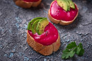 Healthy vegan toasts with beetroot hummus