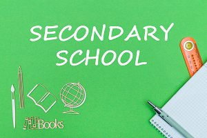 text secondary school, school supplies wooden miniatures, notebook on green background