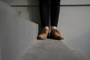 Leather brown shoes of young man