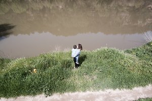 Mother and son on the riverbank