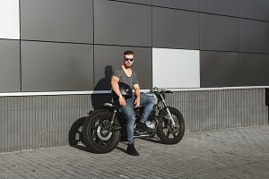 Rider guy with classic motorcycle