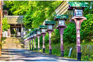 Alley of wooden lanterns at Chorakuji Temple in Kyoto
