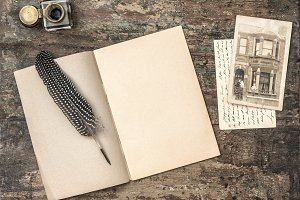 Open book, vintage writing tools