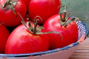 Red tomatoes on tray