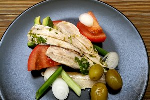 Marinated anchovies with vegetables